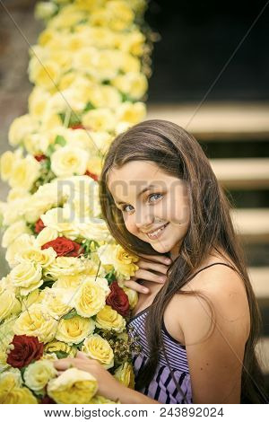 Young Florist. Girl Smile With Yellow Roses, Beauty. Little Child With Flowers, Spring. Beauty, Spri