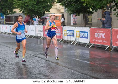 Dnipro, Ukraine - May 20, 2018: Male And Female Participants Running On The Central Street Of Dnipro