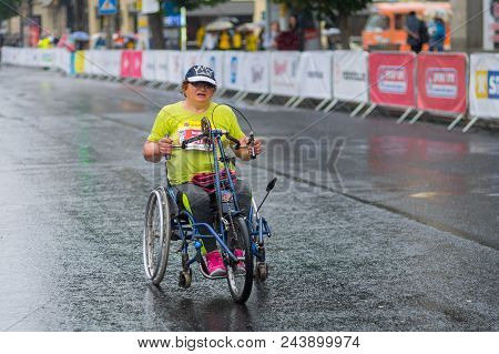Dnipro, Ukraine - May 20, 2018 : Mature Female Participant In A Wheelchair Hurrying To Finish Line D