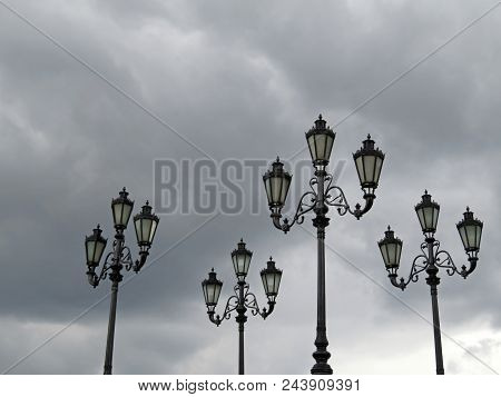 Street Lights On A Dark Sky Background. Power Outage In The City, Electricity Blackout During Storm