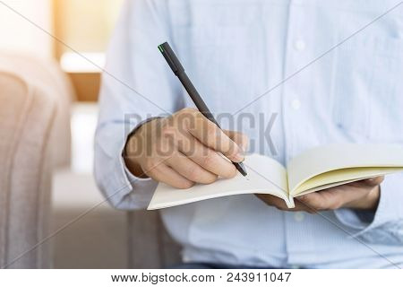 Hand Of Businessman Holding Pen And Notebook, Writing Something Idea On Note Or Check List.