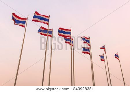 Thai Flags Waving At Sunset Time In Thailand.