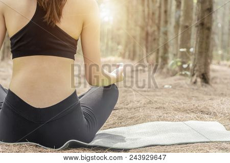 Woman Yoga Relax In The Nature And Sunset