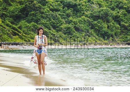 Woman Happy Smiling And Take A Camera On The Beach On A Beautiful . Pretty Girl Asian In Casual Look