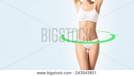 Young, Fit And Sporty Female Body In Swimsuit. Weight Loss, Sport, Diet And Nutrition Concept.
