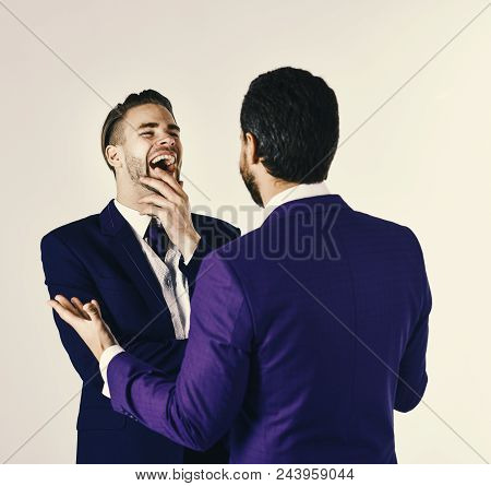 Business And Friendship Concept. Man In Jacket Listening His Business Partner And Laughing. Successf