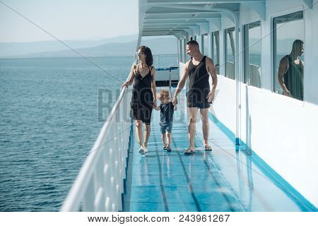 Love And Trust As Family Values. Child With Father And Mother. Mother And Father With Son In Sea Tri