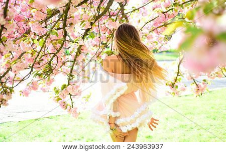 Sakura Flower Beauty In Nature. Womens Day With Girl In Pink Cherry Blossom. Skincare And Summer Con