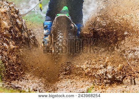 Enduro Rides Through The Mud With Big Splash,driver Splashing Mud On Wet And Muddy Terrain,motocross