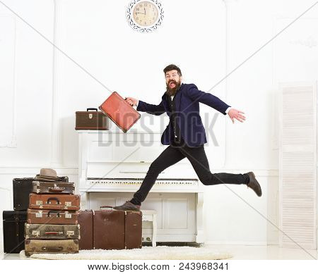 Macho Attractive, Elegant On Cheerful Face Carries Vintage Suitcases, Jumping. Man With Beard And Mu