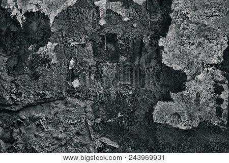 Old Weathered Concrete Wall With Plaster Smears. Grunge Dark Gray Background