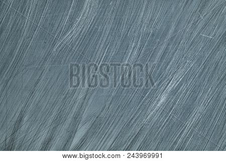 Gray Scratched Metal Texture. Silvery Shabby Metallic Surface. Abstract Dark Background