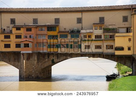 View of Ponte Vecchio. Florence, Italy. Old bridge in Florence view to the Arno River. Famous for the goldsmith shops and the Vasari Corridor, built by the Medici, it allowed them to move from Palazzo Vecchio to Palazzo Pitti without having to cross poster