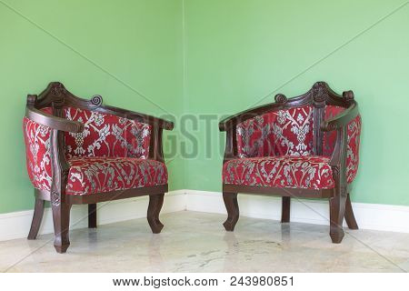 Red Leather Chairs In The Corner With Green Walls As Background.  Interior, Classic, Antique