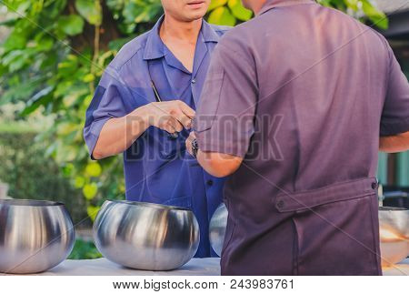 To make merit by offering food to monk ceremony in Thai wedding tradition. Selective focus on rice ladle. poster