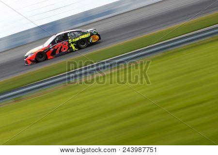 June 03, 2018 - Long Pond, Pennsylvania, USA: Martin Truex, Jr (78) brings his car through the turns during the Pocono 400 at Pocono Raceway in Long Pond, Pennsylvania.