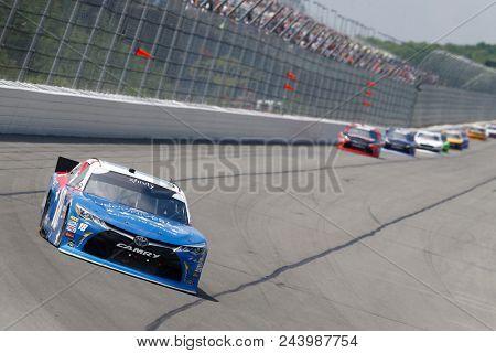 June 02, 2018 - Long Pond, Pennsylvania, USA: Kyle Busch (18) brings his car through the turns during the Pocono Green 250 at Pocono Raceway in Long Pond, Pennsylvania.