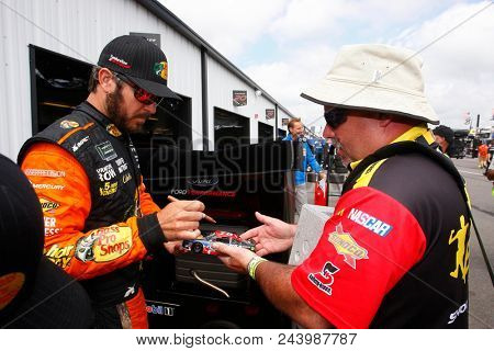 June 02, 2018 - Long Pond, Pennsylvania, USA: Martin Truex, Jr (78) hangs out in the garage during practice for the Pocono 400 at Pocono Raceway in Long Pond, Pennsylvania.