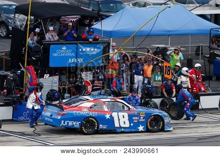 June 02, 2018 - Long Pond, Pennsylvania, USA: Kyle Busch (18) brings his car down pit road for service during the Pocono Green 250 at Pocono Raceway in Long Pond, Pennsylvania.