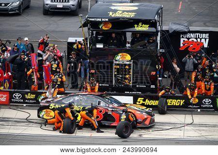 June 03, 2018 - Long Pond, Pennsylvania, USA: Martin Truex, Jr (78) brings his car down pit road for service during the Pocono 400 at Pocono Raceway in Long Pond, Pennsylvania.