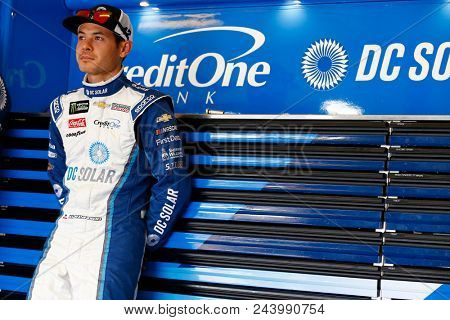 June 02, 2018 - Long Pond, Pennsylvania, USA: Kyle Larson (42) hangs out in the garage during practice for the Pocono 400 at Pocono Raceway in Long Pond, Pennsylvania.