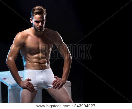 Sexy Handsome Male Model In Underwear. Handsome Muscular Man In White Boxer Shorts. Closeup Of One H
