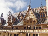 The mosaic roof Hospice in Bon (Hфtel-Dieu de Beaune). France poster