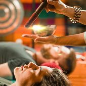 Tibetan singing bowl in sound therapy, color image poster