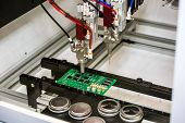 Flexible robotic conformal coating and dispensing system for selective coating potting, bead, and meter-mix dispensing applications poster