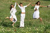 young happy group of women jumping for joy poster