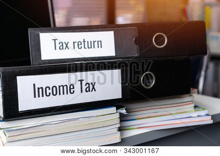 Tax Return And Income Tax Files Binder Of Report, Document In Office. Completion Of Documentation Th