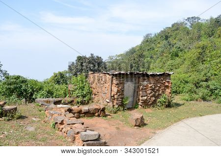 An Old Ruin Abandoned House In Mountain Forest. Damaged Broken Demolished Ruined Fortified Brick Wal