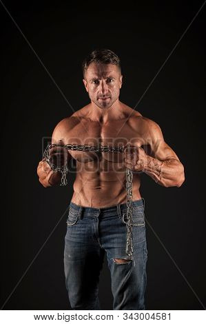 Strong Enough. Feeling Athletic And Powerful. Athletic Man Hold Metal Chain In Strong Hands Black Ba