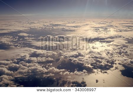 View From Plane Window. Clouds Above Water Surface. Atmosphere Concept. Air Pollution. Greenhouse Ef