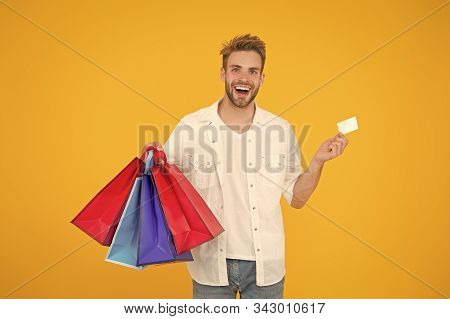 Big Discount. Great Choices Great Purchases. Happy Man Holding Purchases In Paper Bags. Cheerful Cli