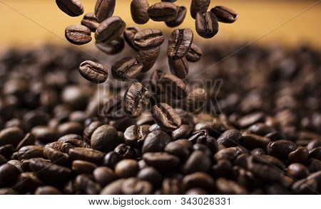 Falling Roasted Coffee Beans On Dark Background