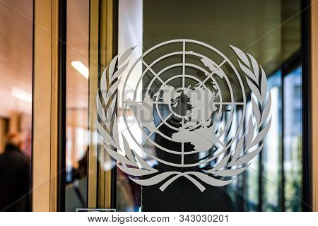 Geneva, Switzerland - April 15, 2019: The United Nations Sign On The Entrance Door Of The Palace Of