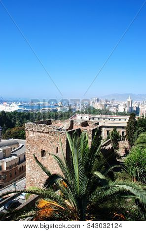 Malaga, Spain - July 7, 2008 - Elevated Harbour View With The Christs Gate Of Malaga Castle In The F