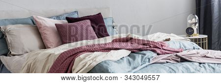 Closeup Of Cozy King Size Bed With Pillows And Blankets