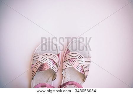 Baby Girl Pink Sandals Isolated On White Background. Baby Fashion Pair Pink Sandals Shoes For The To