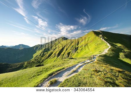Trial path peak Tatra Mountains sun sunset sunrise Nature background clouds panorama Nature background. footpath landscape Nature background Nature background. Travel Tourism hiking Nature background Nature background Nature background summit mountain.