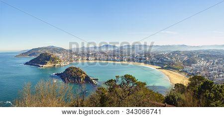 Panoramic View Of The Concha Bay. Concha Beach, Ondarreta Beach And Santa Clara Island From Monte Ig