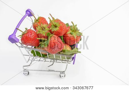 Strawberry Fruit With A Small Cart On A White Background