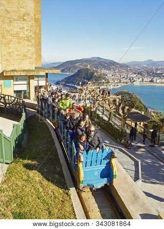 San Sebastian, Spain - December 30, 2019. Tourists On The Roller Coaster Of The Monte Igueldo Amusem