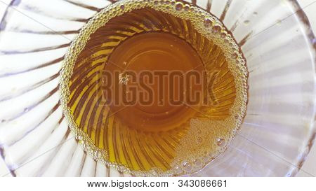 Mustered Oil In Bowl Isolated On Yellow Background