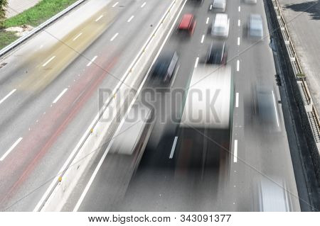 Abstract And Blurred Background Of Many Cars In Street. Blurred Motion