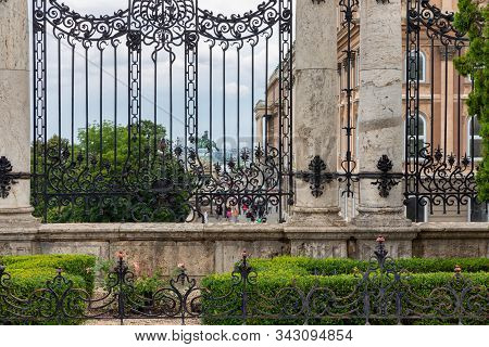 Marble Columns With Decorated Ironwork Gate Near Buda Castle Budapest, Hungary