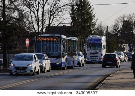 Krakow, Poland 20.12.2019: Late Arrival At The Airport. City Traffic, Traffic Congestion. Cars, Bus