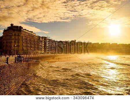 San Sebastian, Spain - December 24, 2019. The Concha Beach Of San Sebastian At Sunset. Basque Countr