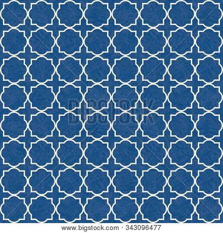 Traditional White Quatrefoil Lattice Design On Watercolor Style Textured Blue Background. Seamless V